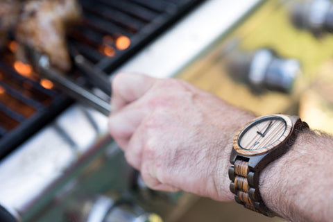 Man Wearing a Tree Hut Wood Watch Making BBQ Chicken