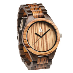 The all wooden watch is equipped with high quality Japan quartz movement and stainless steel tri-fold clasp with push buttons. Diameter of the dial 1.7 inches. Strap and case are made of 100% wood with zebra wood framed with beautiful dark Ebony.  • Ship Next Business Day!  • Watch and Watch Band Made from Real Wood • Japanese Quartz Movement  • Strap Made from Real Wood • Clasp Made from Stainless Steel Tri-Fold with Push Buttons  • Minimalist Design • Durable & Long Lasting