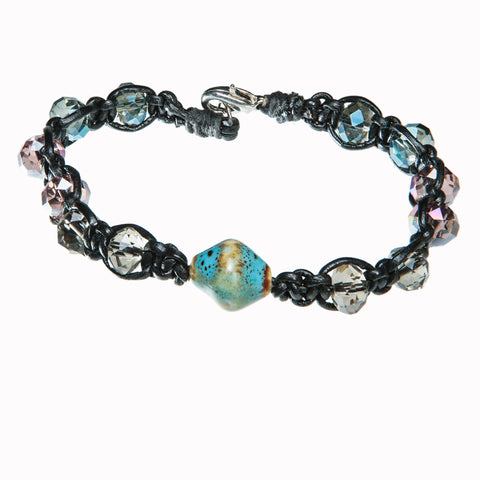 Black leather bracelet with ceramic charm and blue and pink crystal