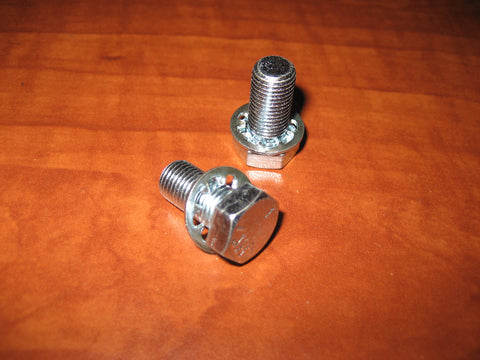 Spacer block with mating serrations for bolt-on Hurst shifter stick lever handle
