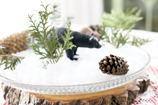 fake snow bear and beaver greenery christmas decorations middle of table