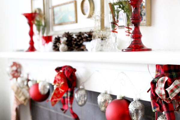 fireplace decorations red bows and lights and red balls