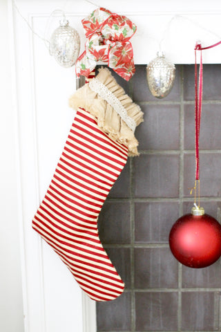 stripped stocking over fireplace with bow