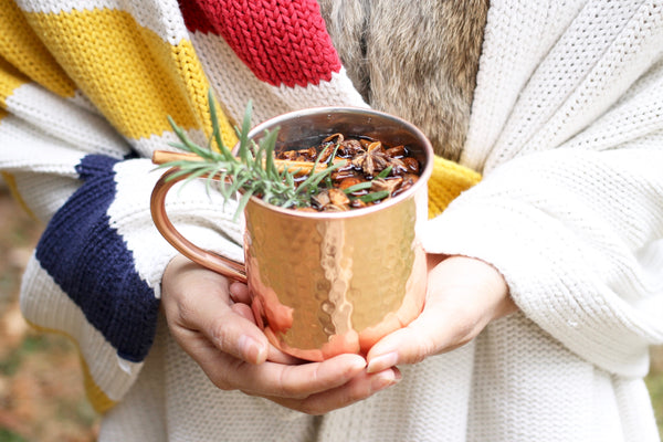 rose gold coffee mug with hudson bay stripe blanket log cabin