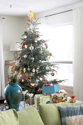 decorated mix matched ornaments christmas tree with green couch