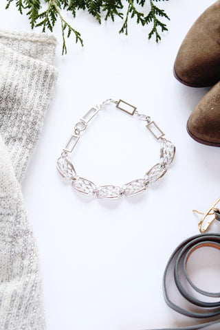 silver and sleek vintage choker