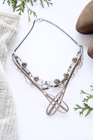 bold layered silver necklace snowshoe inspired vintage cool designer in toronto