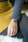 woman wearing a vintage inspired bracelet with colourful jewels