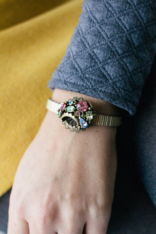 woman wearing a vintage inspired watch bracelet with colourful jewels