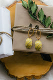 mustard yellow statement vintage earrings handmade in toronto jewelry holiday flat lay image