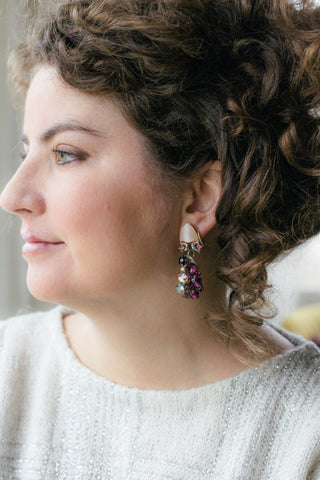 girl in sparkly sweater with purple and pink long vintage earrings handmade in toronto