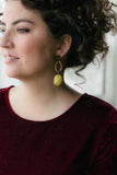 mustard yellow statement earrings on girl with velvet dress and curly hair handmade in toronto