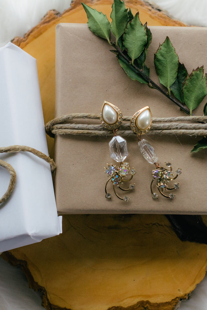 flat lay jewelry with presents on wood, pearl and gold statement earrings with vintage crystals handmade in toronto