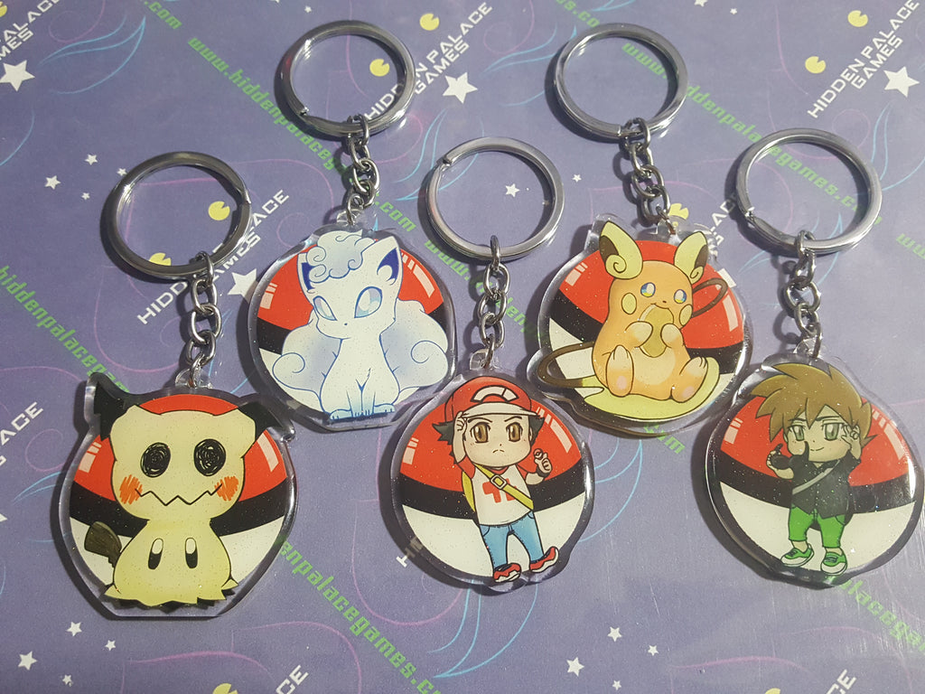 2 Double Sided Glitter Pokemon Keychains Hidden Palace Games