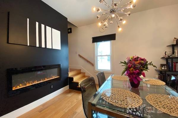 Long linear fireplace in a dining room