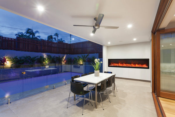 Panoramic Fireplace With Multi Color Flame Brings Life To This Monochrome  Outdoor Dining Room.