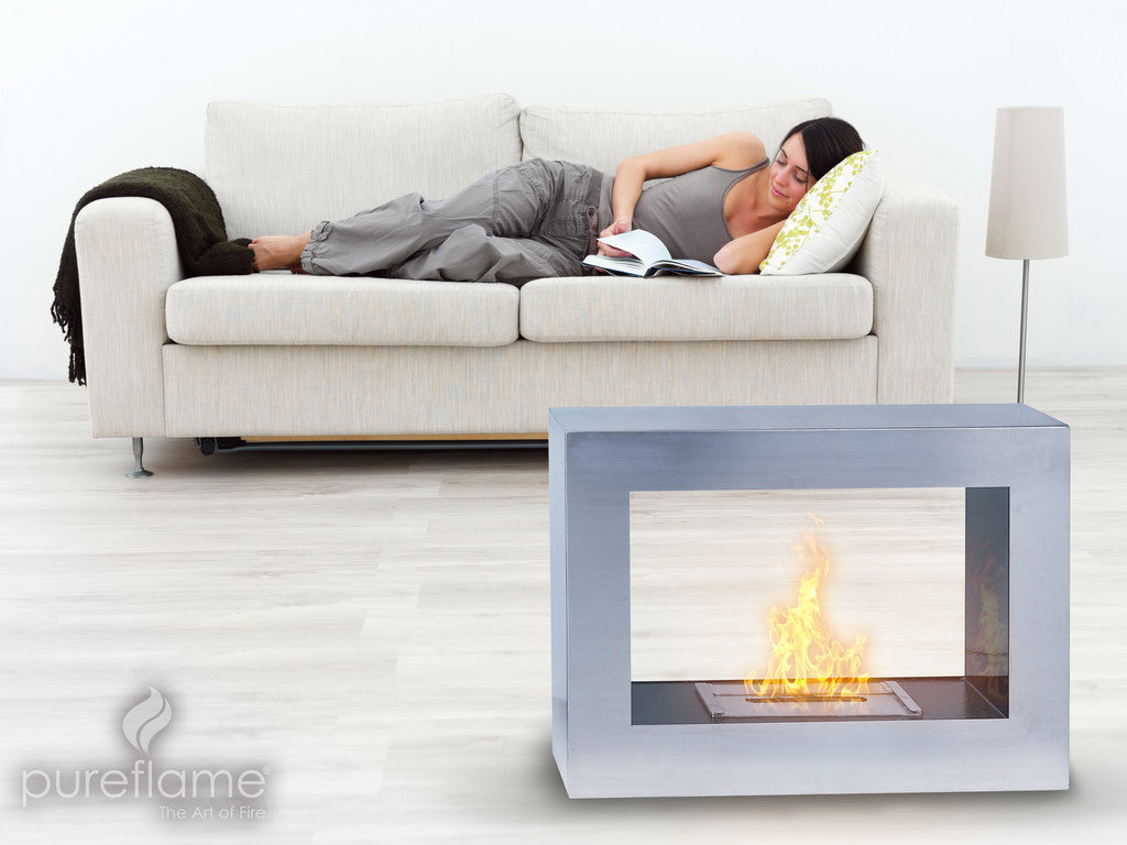 Two sided freestanding fireplace by the couch