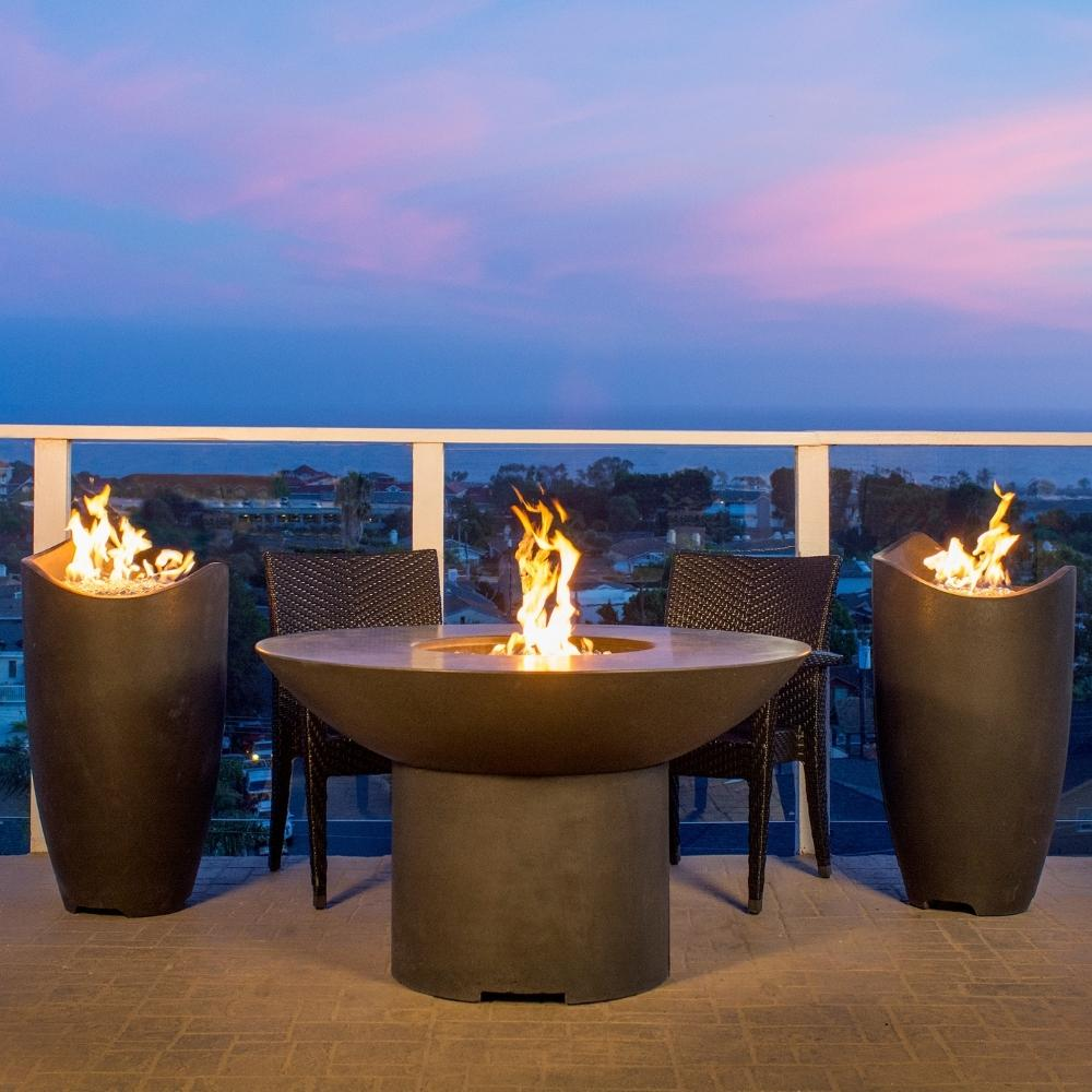 American Fyre Designs Lotus Fire Table with Wave Fire Urns