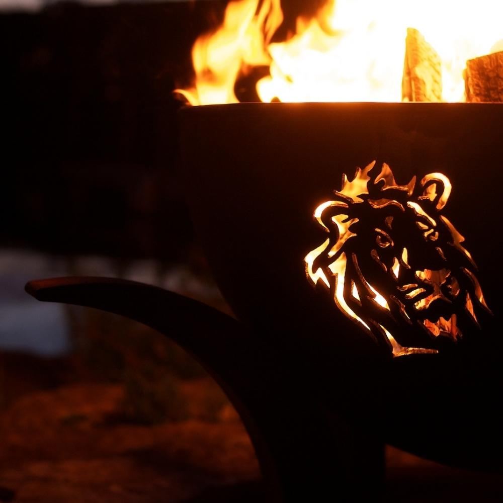 Lion Design of Fire Pit Art Africa's Big Five With Burning Logs