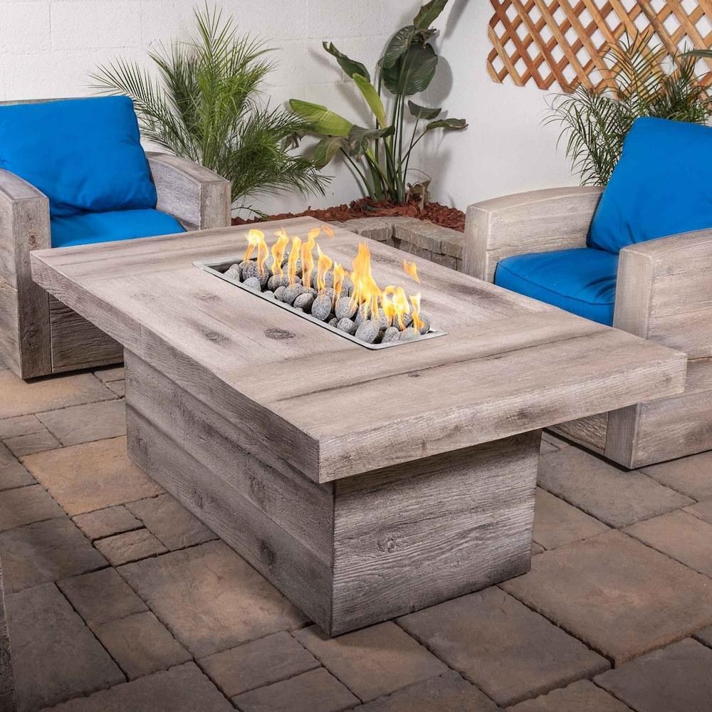 "Top Fires Grove 60"" Rectangular GFRC Fire Table in outdoor living area"