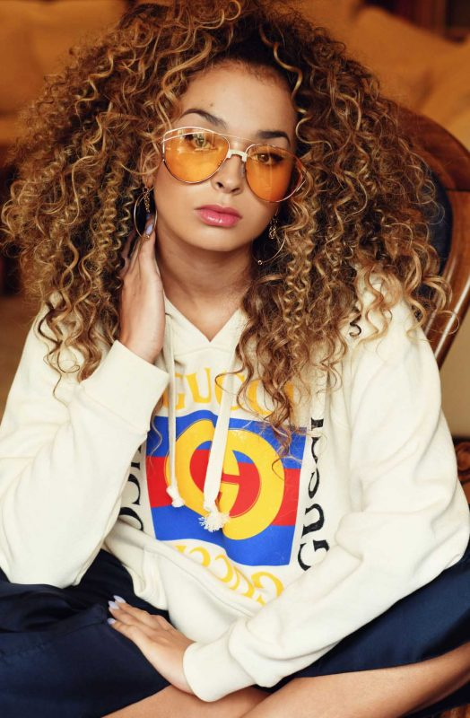 ELLA EYRE WEARS FOR ART'S SAKE DESIGNER SUNGLASSES DARK EYES AMBER