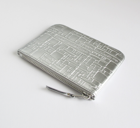 All new embossed metallic logo designs are in! The Zip wallet in silver ... click for more information