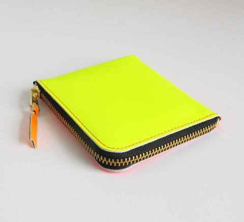 The Zip Wallet in Super Fluro is neon pink one side and yellow the other... click for more information