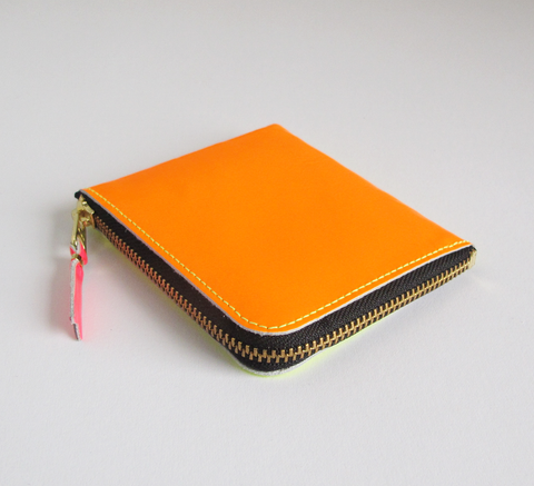 The Zip Wallet in Super Fluro is neon yellow one side and light orange t... click for more information