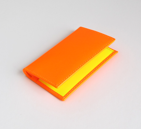 The Card Holder with a super fluro light orange exterior has a pop of co... click for more information