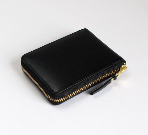 This new wallet design is available in black leather, similar in size to... click for more information