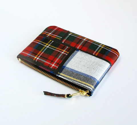 The Zip wallet in red patchwork is a simple pouch with a matching zip. F... click for more information