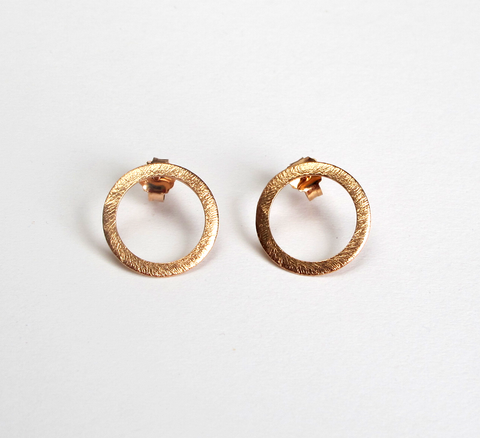 The burnished texture of rose gold Open Coin earrings adds an interesti... click for more information