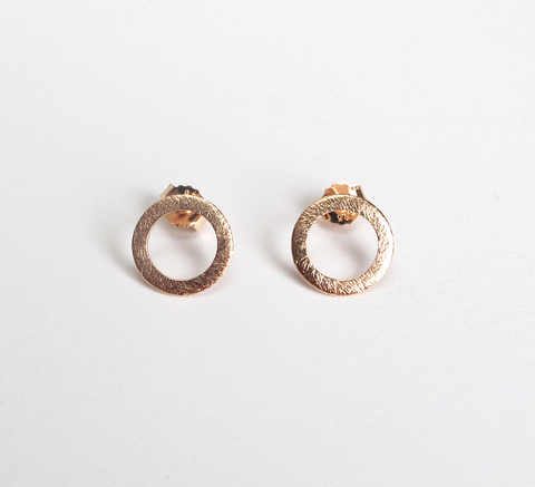 The burnished texture of the Small Open Coin earrings adds an interesti... click for more information