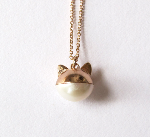 Benedicte's the Le Chat pendant is now available in rose gold! The charm... click for more information