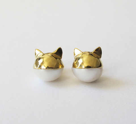 We love this updated version of Benedicte's pearl cat earrings. Watch ou... click for more information