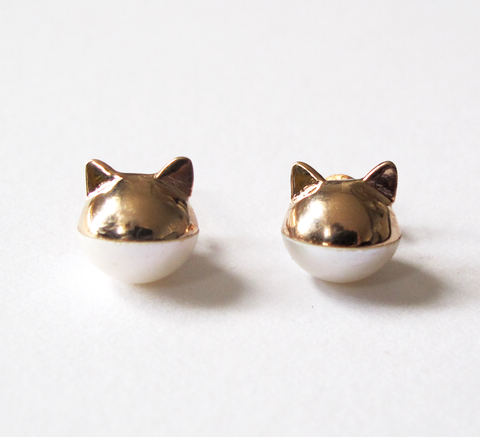 We love this updated version of Benedicte's pearl cat earrings now avail... click for more information