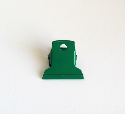 A small green clip perfect for office work or can be hooked on to the wa... click for more information