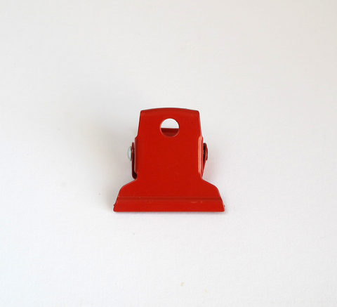 A small red clip perfect for office work or can be hooked on to the wall... click for more information