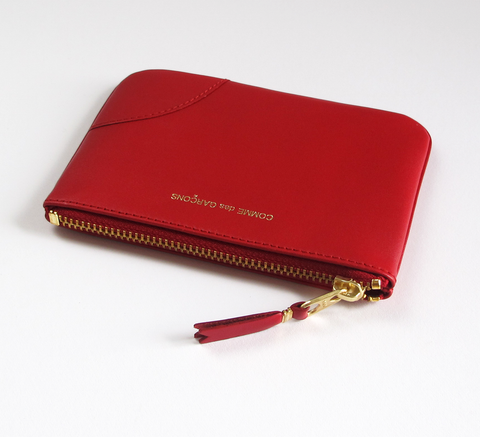 The Zip wallet in red is a simple pouch in soft leather with a complimen... click for more information