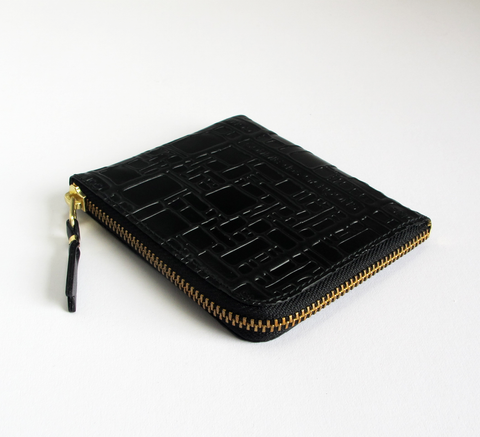 The new embossed design is in! The Zip Wallet in black opens across two ... click for more information