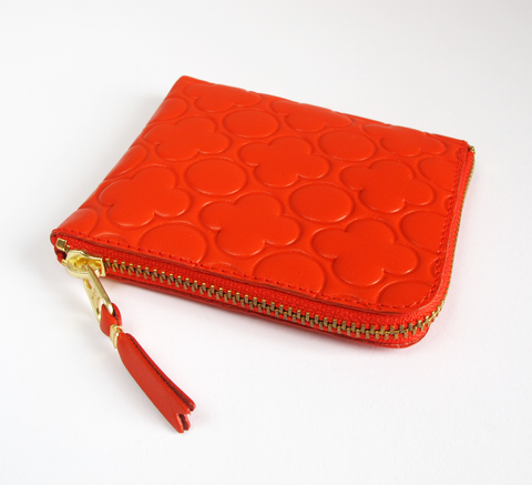 The Zip Wallet in embossed orange opens across two sides featuring a poc... click for more information