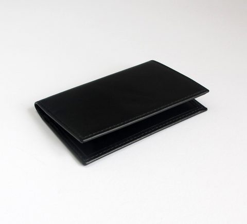 The card holder in black by Comme des Garcons features two interior card... click for more information
