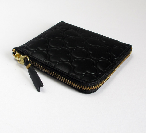 The Zip Wallet in embossed black opens across two sides featuring a pock... click for more information