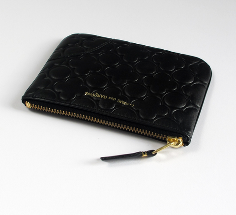 Fhe Zip wallet in embossed black is a simple pouch in soft leather with ... click for more information