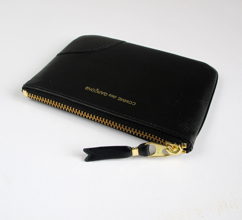 The Zip wallet in black is a simple pouch in soft leather with a complim... click for more information