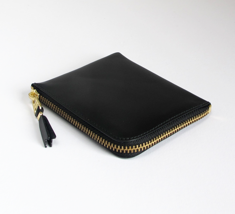 The Zip Wallet in classic black opens across two sides featuring a pocke... click for more information