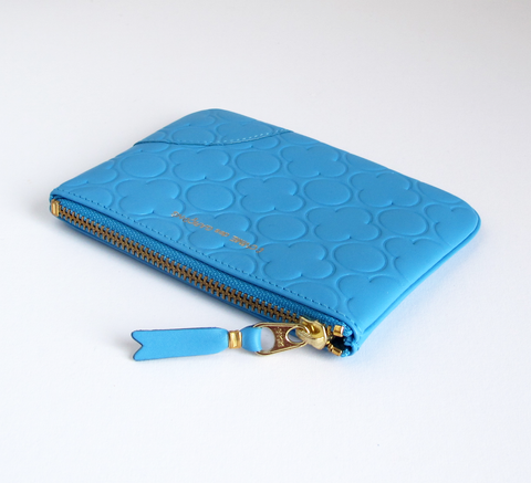 The Zip wallet in embossed blue is a simple pouch in soft leather with a... click for more information
