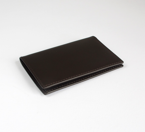 The card holder in brown by Comme des Garcons features two interior card... click for more information