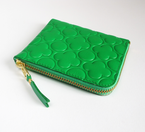 The Zip Wallet in embossed green opens across two sides featuring a pock... click for more information
