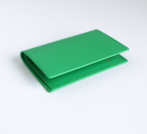 The card holder in green by Comme des Garcons features two interior card... click for more information